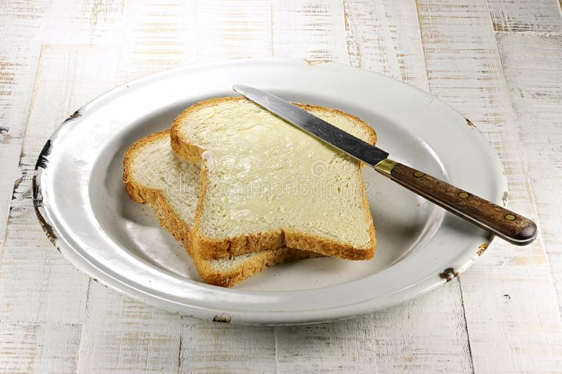Buttered bread stock photo