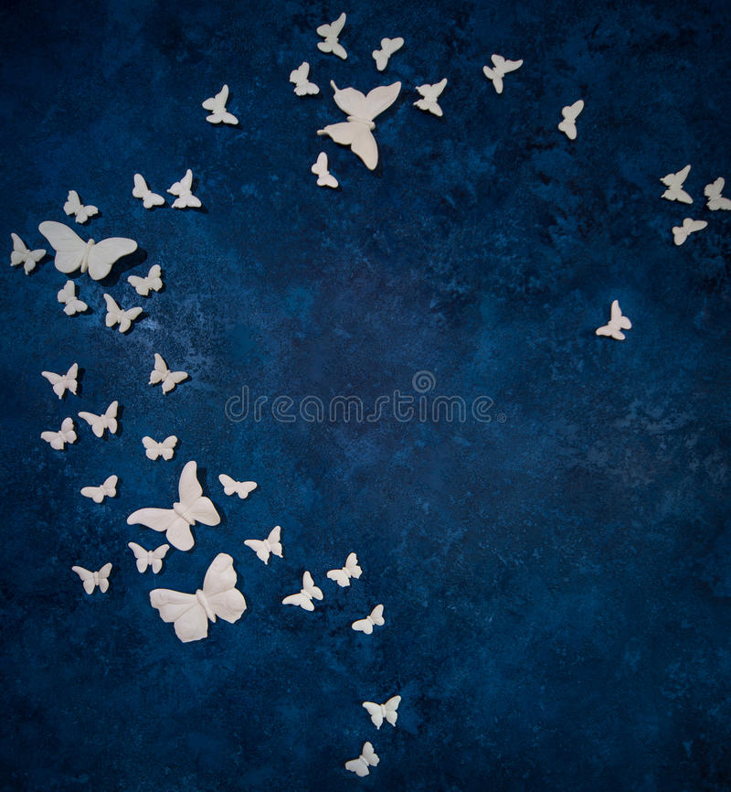 Butterflies Over Dark Blue Background Royalty Free Stock Photography