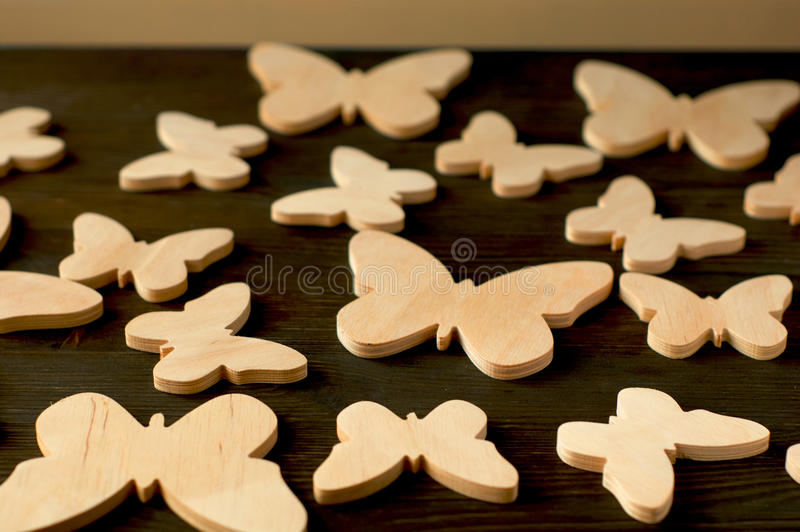 Butterflies of wood on a black wooden background.  royalty free stock photo
