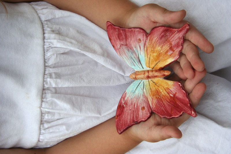 Butterfly 2. A child holds a butterfly stock photos
