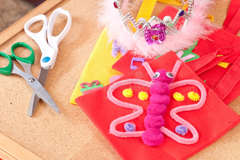 Butterfly Arts and Crafts ( Education ). School craft on a cork board stock photo