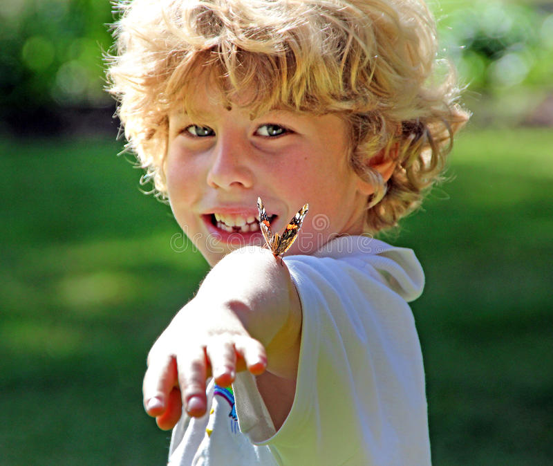 Butterfly boy. A rare wow moment when a young boy has a painted lady butterfly land on his arm when visiting a kent park in whitstable during summer of 2016