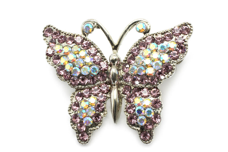 Butterfly brooch. On white a background stock photos