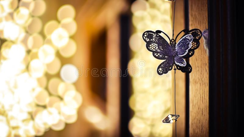 Butterfly chain with blurred lights background for romantic evenings. Butterfly chain closeup stock photography