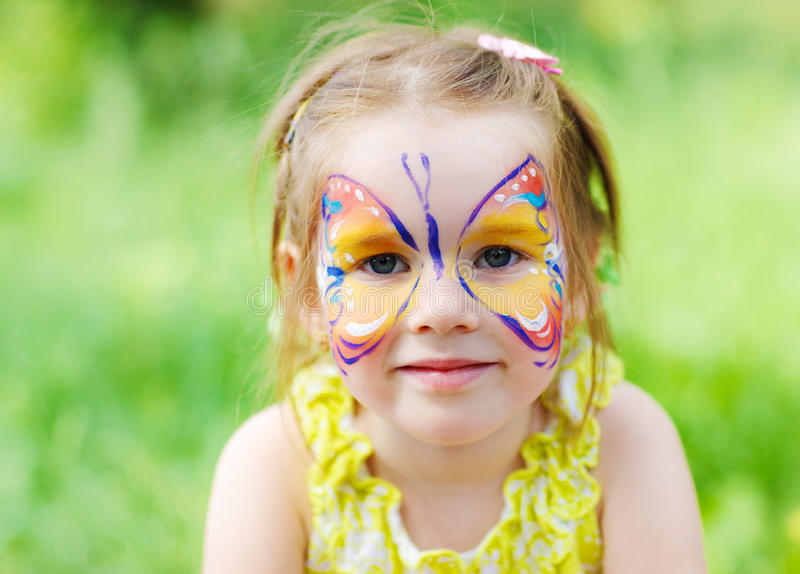 Butterfly face design. Butterfly design on the face of a preschool girl stock photography