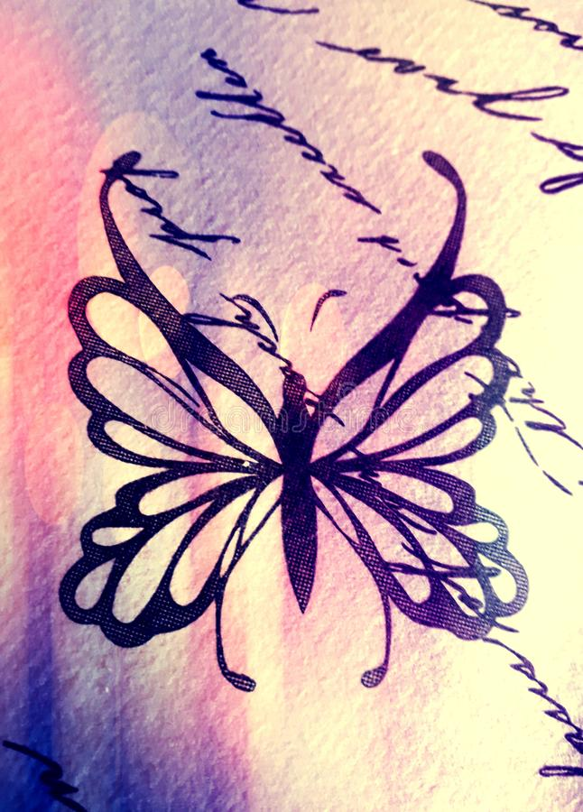 Butterfly symbol on a table. The butterfly. A fashinating animal, a spiritual symbol of freedom, purity and soul. Choose it to create your logo or your wallpaper stock photo