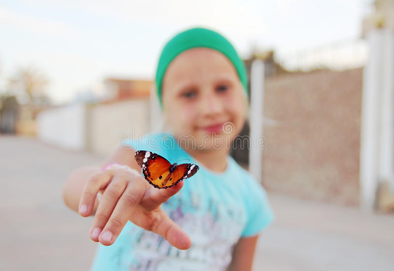 Butterfly on finger royalty free stock photography