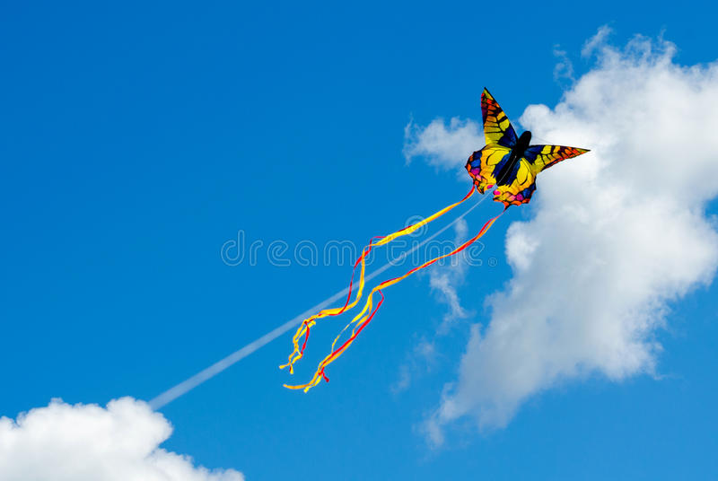 Butterfly kite in a blue sky stock photos