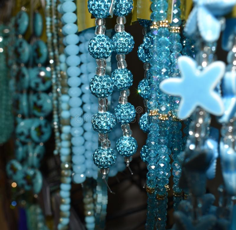 Beaded jewelry with blue teal turqouis gems and gold and silver stock photography