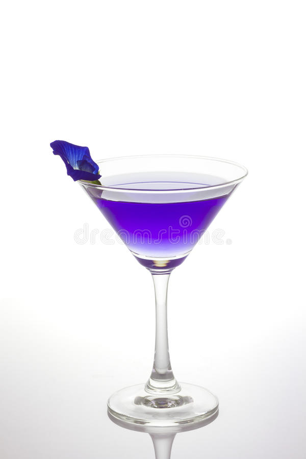 Butterfly pea flower juice in cocktail glass stock image
