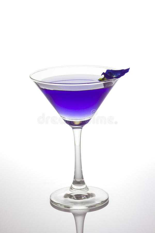 Butterfly pea flower juice in cocktail glass stock images