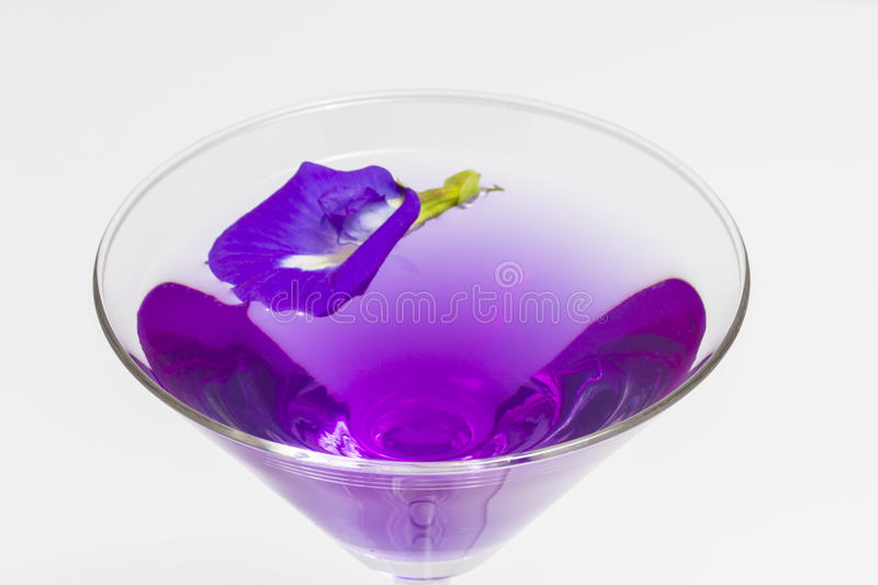 Butterfly pea flower juice in cocktail glass that is qualify as an antioxidant with clipping path royalty free stock photography