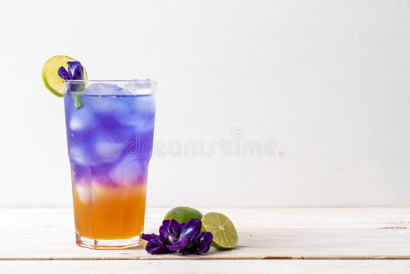Butterfly pea juice with honey and lime. Healthy drink stock photo