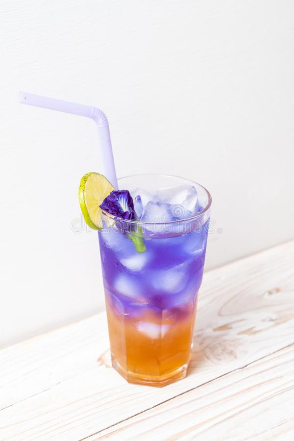 Butterfly pea juice with honey and lime. Healthy drink royalty free stock images