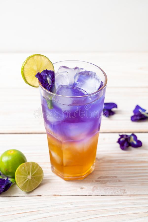 Butterfly pea juice with honey and lime. Healthy drink royalty free stock image