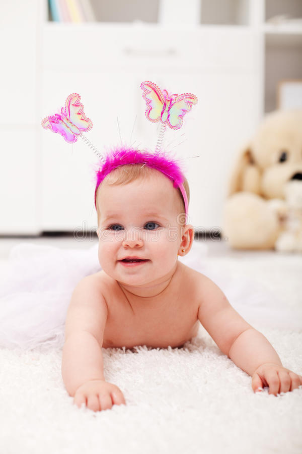 Butterfly princess crawling - baby girl on the floor royalty free stock image