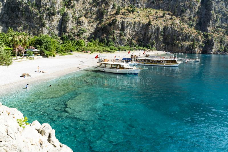 BUTTERFLY VALLEY BEACH, TURKEY - JUNE 01: Tourists visit famous. Butterfly Valley beach near Oludeniz in Turkey on JUNE 01, 2016. Butterfly Valley beach is one royalty free stock images