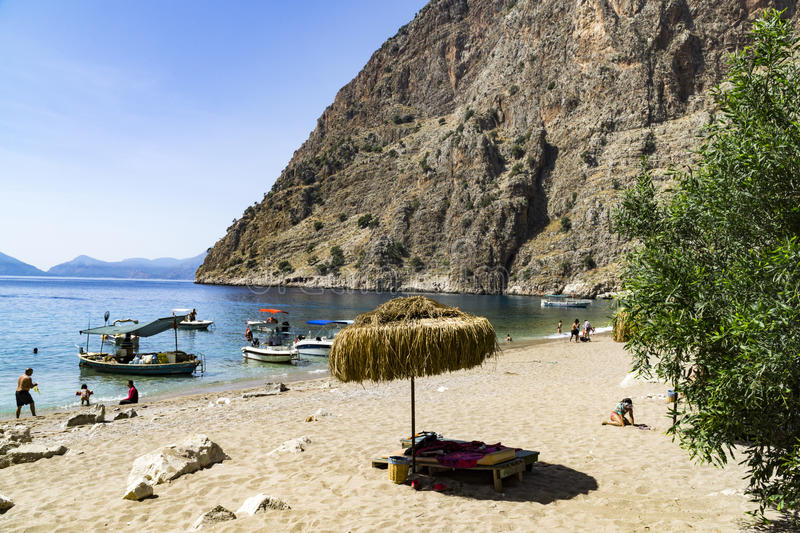 BUTTERFLY VALLEY BEACH, TURKEY - JUNE 01. Tourists visit famous Butterfly Valley beach near Oludeniz in Turkey on JUNE 01, 2016. Butterfly Valley beach is one stock image