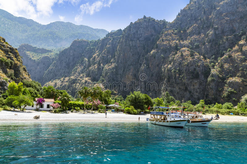 BUTTERFLY VALLEY BEACH, TURKEY - JUNE 01. Tourists visit famous Butterfly Valley beach near Oludeniz in Turkey on JUNE 01, 2016. Butterfly Valley beach is one stock photography