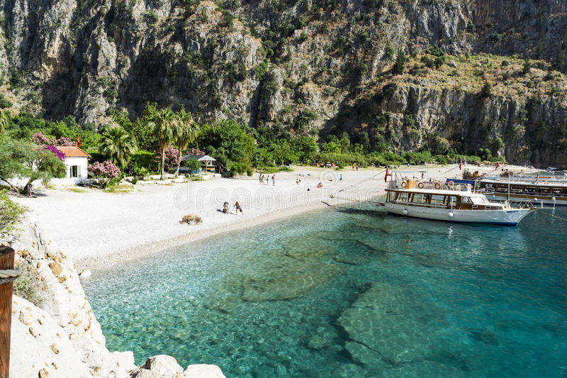 BUTTERFLY VALLEY BEACH, TURKEY - JUNE 01. Tourists visit famous Butterfly Valley beach near Oludeniz in Turkey on JUNE 01, 2016. Butterfly Valley beach is one stock photo