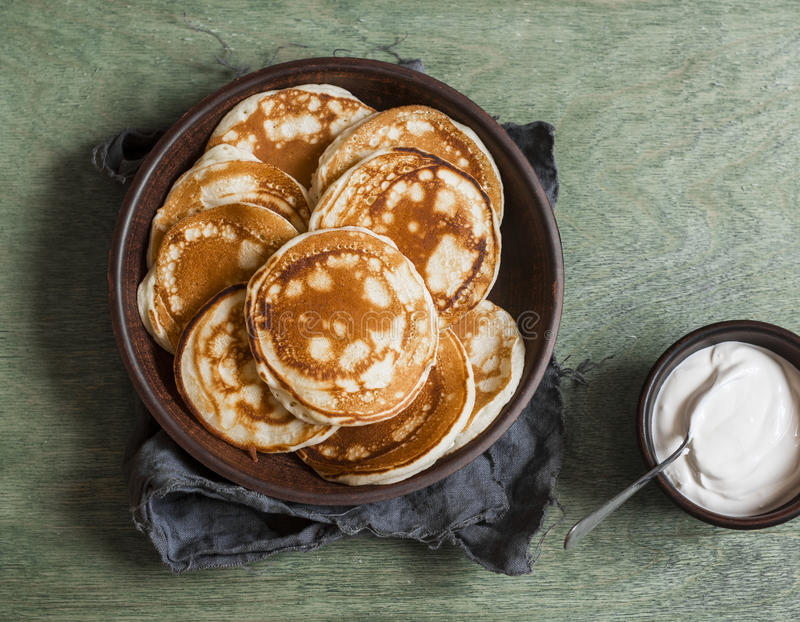 Buttermilk pancake and cream. Delicious Breakfast on a wooden table. Top view royalty free stock image
