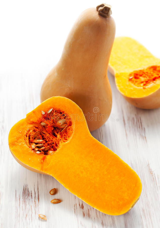 Butternut squash. Whole and halved stock photo