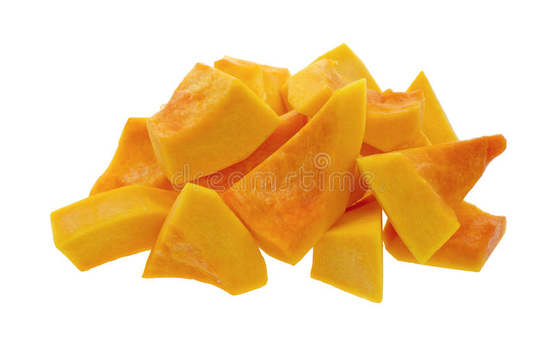 Butternut squash. A group of cut and slice butternut squash chunks on a white background stock photo