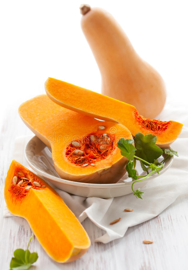 Butternut squash. Whole and halved stock photos