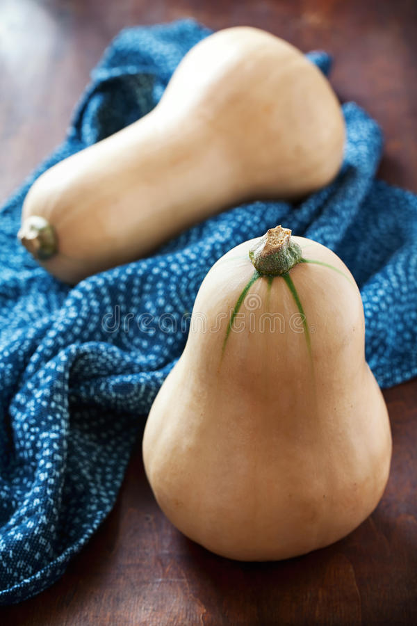 Butternut squash. On a wooden table royalty free stock photo