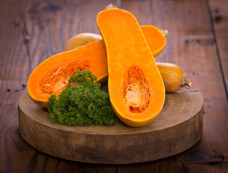 Butternut squash. On the wooden table royalty free stock photography