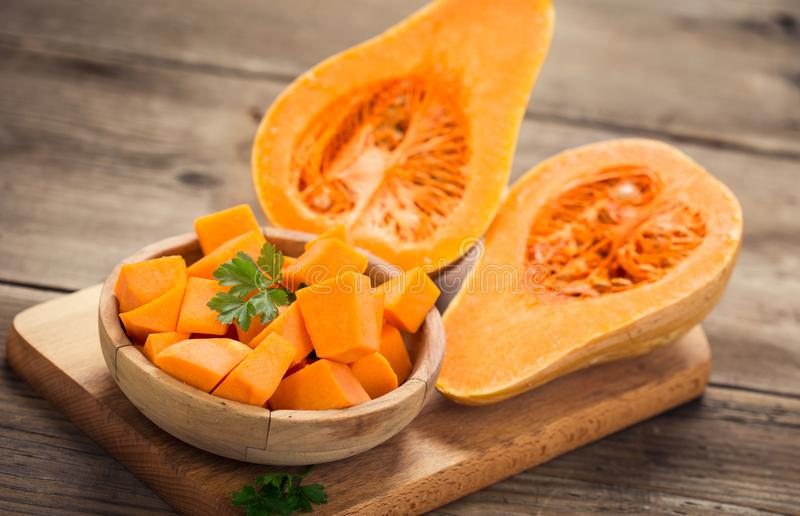 Butternut squash. On the wooden table stock photography