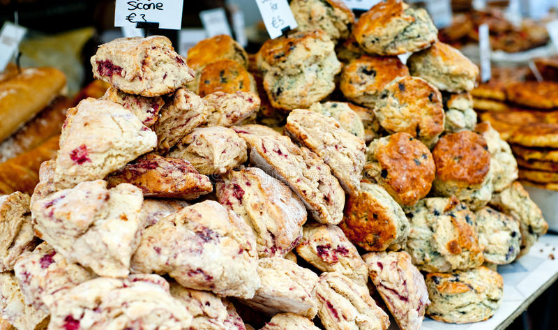 Butterscotch and cranberry scones stock photos