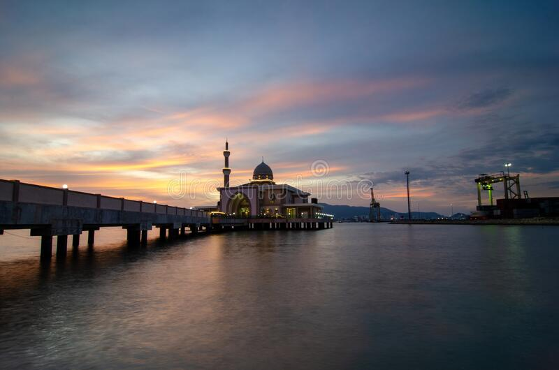 Butterworth, Malaysia floating mosque. With dramatic sunset cloud with container terminal as background stock photos