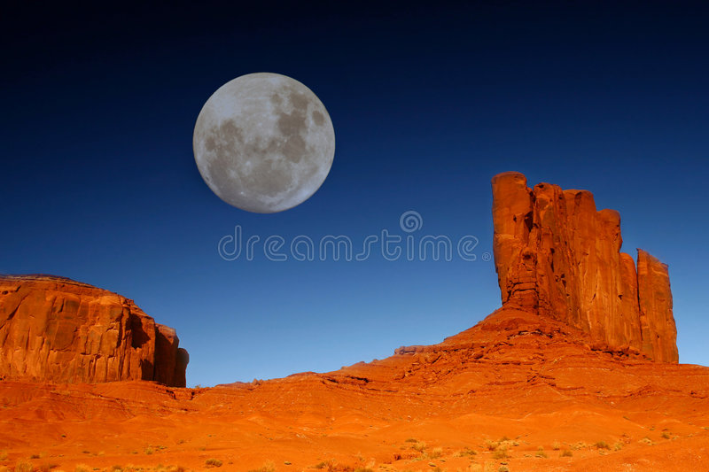 Buttes and Moon in Monument Valley Arizona stock photo