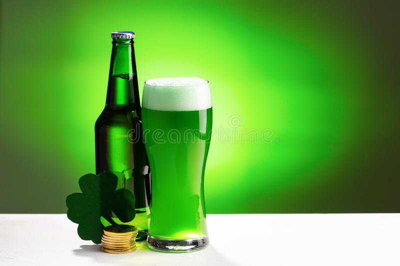 Buttle and glass of fresh green cold beer. Concept for St. Patrick`s day. stock photos