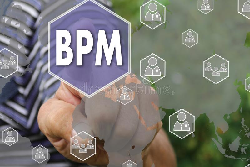 Button BPM, Business Process Management on the touch screen. Farmer businessman pushes a button BPM, Business Process Management on the touch screen, analysis stock images