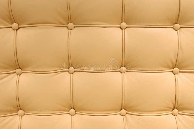 Button leather pattern. Brown Button leather pattern of a sofa royalty free stock photo