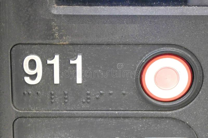 911 Button. A red button to call 911, the emergency system in the United States stock photography
