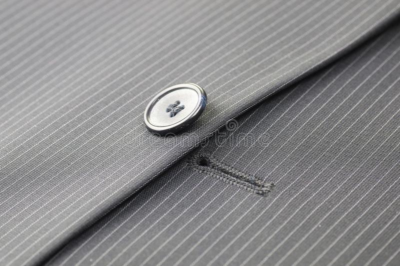 Button suit stripe. Four gray buttons sewn on the sleeve men's suit system stock images