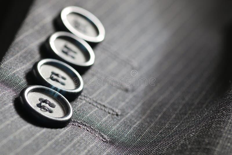 Button suit stripe. Button of suit stripe grey colored clothes stock photo