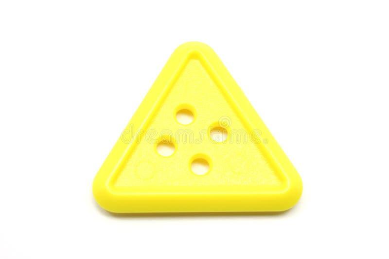 button triangelyellow royaltyfria foton