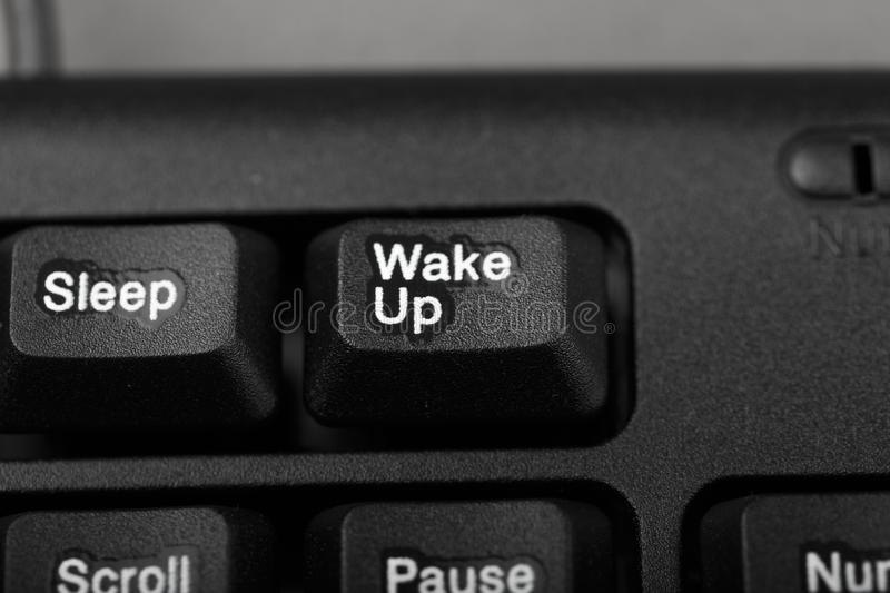 Button, wake up and sleep on the keyboard stock images