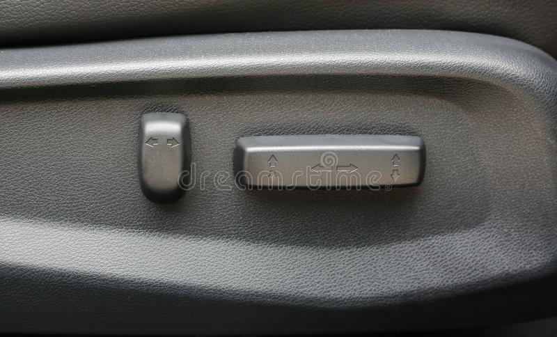 Buttons for adjusting seat position. Car interior detail.  royalty free stock image