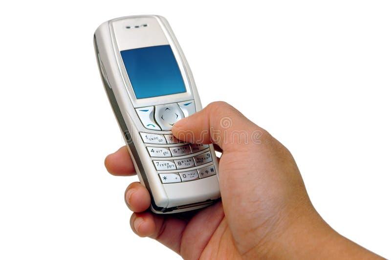 buttons celltelefonen som trycker på s royaltyfria bilder