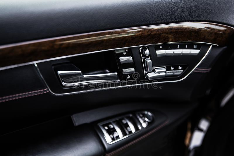 Buttons and control mechanisms on the car door trim at shallow depth of field stock photo