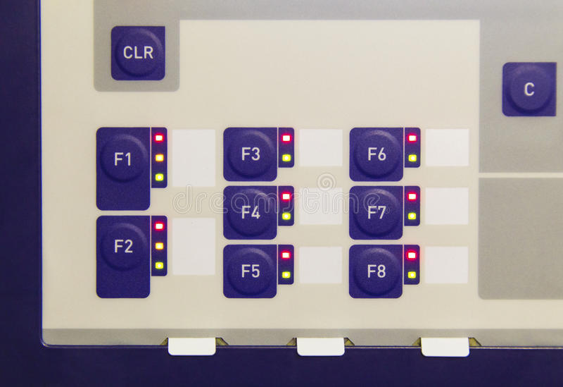 Buttons on control panel of electronic control device. Closeup royalty free stock image