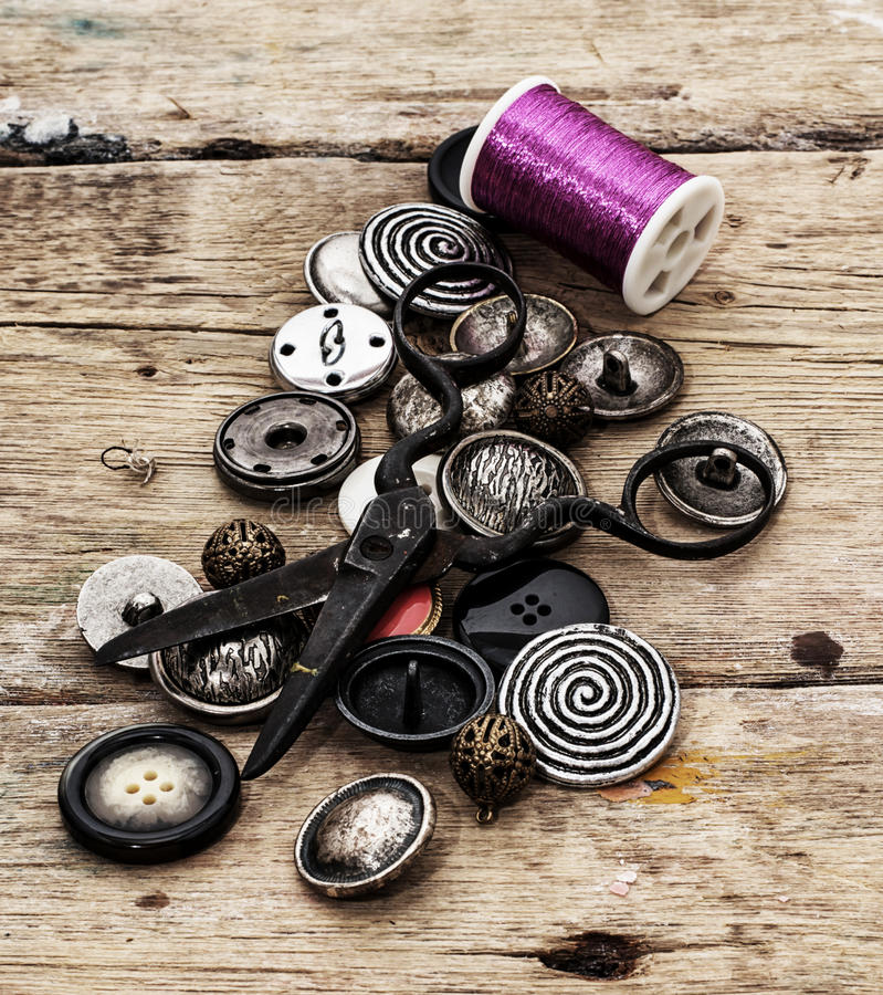 Buttons. Different buttons and zipper on the background of sewing tool stock image