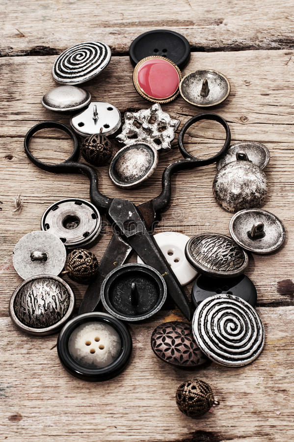 Buttons. Different buttons and zipper on the background of sewing tool royalty free stock image