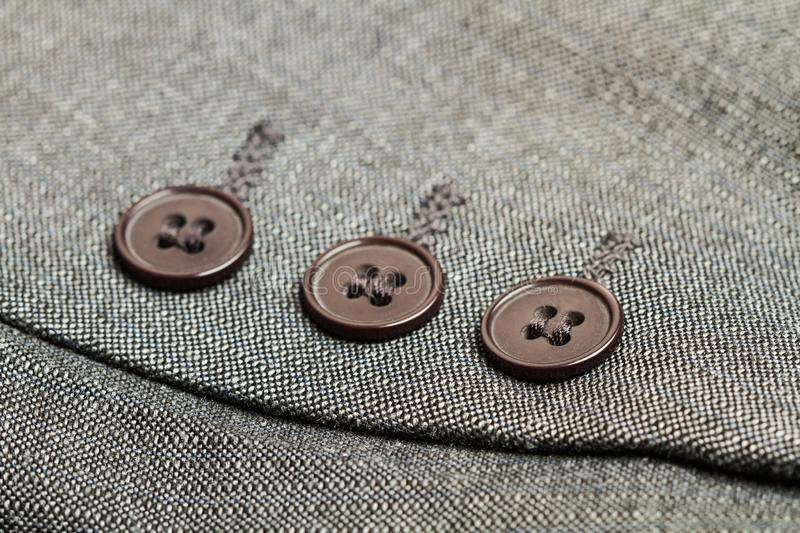 Buttons of a gray suit royalty free stock image