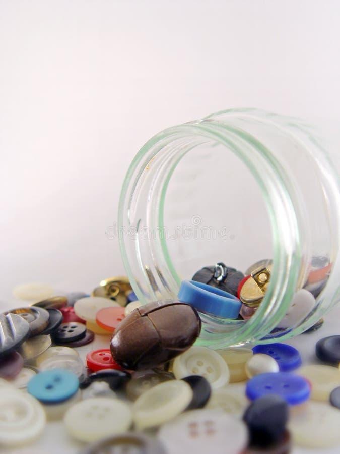 Buttons jar. A jar of buttons stock photos